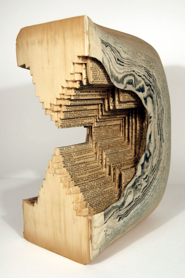 Insane art carving books with surgical tools one page at
